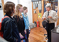The Chittendon Falls hydro dam operator talks with Skidore students including Caroline Hobbs '16, center.